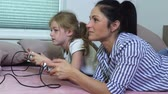 heyecan verici : Daughter and mother playing computer game at home