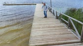 doente : Disabled man with crutches at the lake