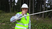 handy : Forest worker after injury with crutches at the woods Stock Footage