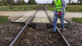 meslek : Railroad worker checking railway crossing