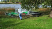 инвалид : Man with crutches going near fishing boats