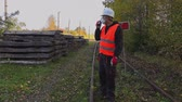 Railway Engineer in the air mask on walkie-talkie Vídeos