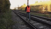 empregado : Railway Engineer  walk on railway rails Stock Footage