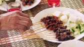 raya : A plate of satay with ketupat and cucumber