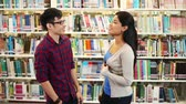 campus : Two friends at a library Stock Footage
