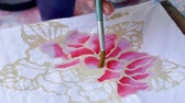 щеткой : Slow motion of closeup shot on batik painting process
