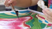 kreatywne : Slow motion of canting process on batik artwork Wideo