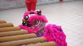 simbolismo : Lion dance performance at local temple