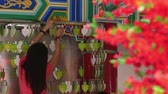 simbolismo : Woman organizing wishing cards at local temple Stock Footage