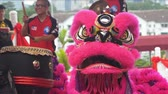 Лев : Lion dance performance at local temple