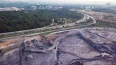 road top view : Aerial view of highways next to a construction site