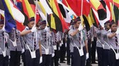 独立性 : Scouts marching with Malaysian state flags on Malaysian Independence Day