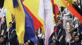 独立性 : Participants marching with Malaysian state flags on Malaysian Independence Day 動画素材