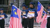 kültürel : Participants waiting to march on Malaysian Independence Day Stok Video
