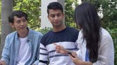 chinka : Friends chatting outdoors Wideo