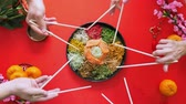Making star shape with chopsticks on top of the yee sang