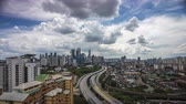 no people : Time Lapse - Clouds and traffic moving at Kuala Lumpur city, high angle view. Stock Footage