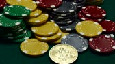 pénz : Bitcoin and casino chips on gambling table