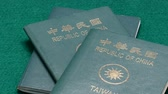 security : Taiwanese passports on green table