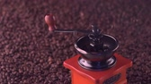 pieczeń : roasted coffee beans falling into hand grinder