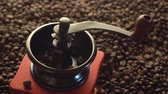 джут : Top view vintage manual coffee grinder with beans. hand pours coffee beans with a wooden spoon. Стоковые видеозаписи