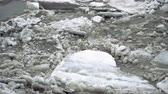 thin ice : Frozen ice river is melting in spring with ice flakes flowing. Cracked ice floating on the river in spring time. Global warming