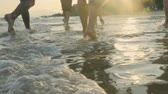 mladistvý : young asian adults walking on beach in sea water, slow motion.