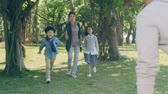 gioconda : lovely asian boy running towards and getting lifted by father in park