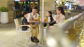 happy asian family with two children chatting relaxing at a coffee place