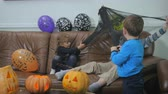 party : Little children play with spiderweb on Halloween