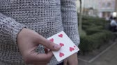 walizka : Male hands show trick with a deck of cards. Man shuffle a pack of the cards. Illusionist shows focus. Focus with cards. Wideo