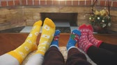 socks : Feet in bright socks at home. Family with kid relaxing on the weekend together.
