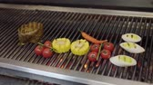 портативный : Unrecognized chef cooking vegetable on the grill in the restaurant kitchen close-up. Meat, corn, cherry tomatoes, lemongrass and chili pepper in the modern restaurant