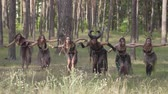 актриса : Beautiful young women in theatrical costumes of forest nymphs pr devils dancing in forest showing perfomance or making ritual