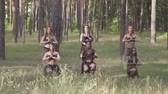 ďábel : Group of women dancers with make-up and in mystical fabulous costumes dancing groovy dance in the forest. Forest fairies, dryads have fun among the trees. Performance of dancers outdoor.