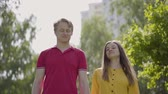 amante : Happy caucasian couple in love walking in green spring park Stock Footage