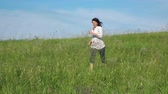 description : Slow motion video - woman running on a green lawn. Full HD stock footage clip.
