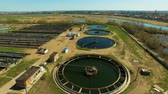 egészségügyi : Aerial view of Wastewater treatment plant. Drone moving forward. Aerial stock footage at summer season.