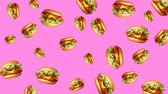 bilboard : Abstract colorful animation - burger color background. Burgers rotating - seamless loop.