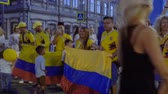 uruguay : SAMARA - JUNE 28, 2018: Colombia football fans celebrating the victory of the Colombian team at the World Cup 2018 at night on June 28, 2018 in Samara, Russia. Stock Footage