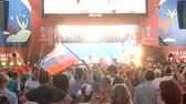 uruguay : SAMARA - JUNE 25, 2018: Football fans dancing and waving hands and flags after the game FIFA FAN FEST zone. World Cup 2018 on June 25, 2018 in Samara, Russia.