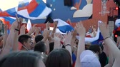 uruguai : SAMARA - JUNE 25, 2018: Slow motion - football fans waving hands and flags, before the game FIFA FAN FEST zone. World Cup 2018 on June 25, 2018 in Samara, Russia. Stock Footage