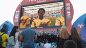 senegal : SAMARA - JUNE 28, 2018: Football fans watching the game on the big screen at the official FIFA FAN FEST zone. World Cup 2018 on June 28, 2018 in Samara, Russia.