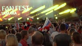 uruguay : SAMARA - JUNE 25, 2018: Slow motion - football fans dancing and waving hands after the game FIFA FAN FEST zone. World Cup 2018 on June 25, 2018 in Samara, Russia.