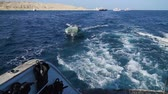 nautical equipment : Boat bobs on the waves in the sea. slow motion video.