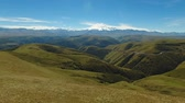 elbrus : Aerial landscape view of the mountains of Elbrus - the highest mountain in Europe Stock Footage