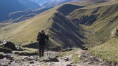 elbrus : Hiker woman walking mountains
