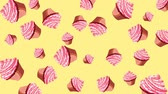bolinho : Abstract colorful animation - pink cupcakes background. Cupcakes rotating - seamless loop. Stock Footage
