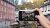 Tourist taking a photo of the beautiful river. Monschau, Germany Vídeos