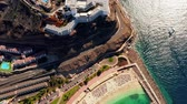 seascape : Beautiful aerial view of the full Playa de Amadores bay beach on Gran Canaria island in Spain. Stock Footage